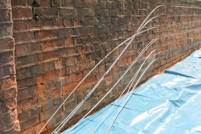 Rebar installation into the bridge masonry