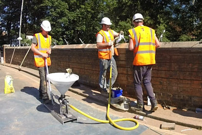 Injecting the grout into the parapet